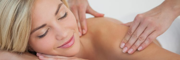 Pretty blonde enjoying a massage